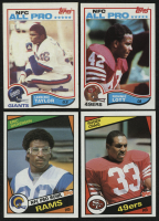Lot of (4) Football Cards with 1984 Topps #353 Roger Craig RC, 1984 Topps #280 Erik Dickerson RC, 1982 Topps #486 Ronnie Lott RC & 1982 Topps #434 Lawrence Taylor RC