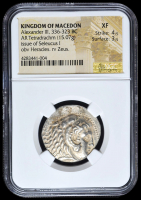 336-323 BC Kingdom of Macedon Alexander III AR (Silver) Tetradrachm (15.07g) Issue of Seleucus I obv Heracles rv Zeus (NGC XF) Strike: 4/5, Surface: 3/5