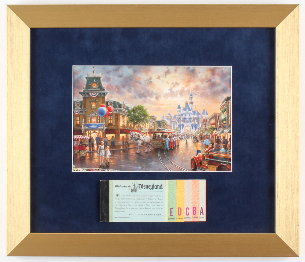 Thomas Kinkade Disneyland 12.5x14.5 Custom Framed Print Display with Vintage Ticket Booklet at PristineAuction.com