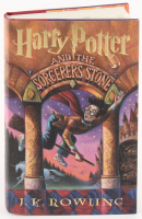 """Daniel Radcliffe Signed """"Harry Potter and the Sorcerer's Stone"""" Hard Cover Book (PSA COA)"""