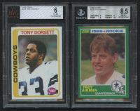 Lot of (2) Beckett Graded Dallas Cowboys Rookie Cards with 1978 Topps #315 Tony Dorsett RC (BVG 6) & 1989 Score #270 Troy Aikman RC (BGS 8.5) at PristineAuction.com