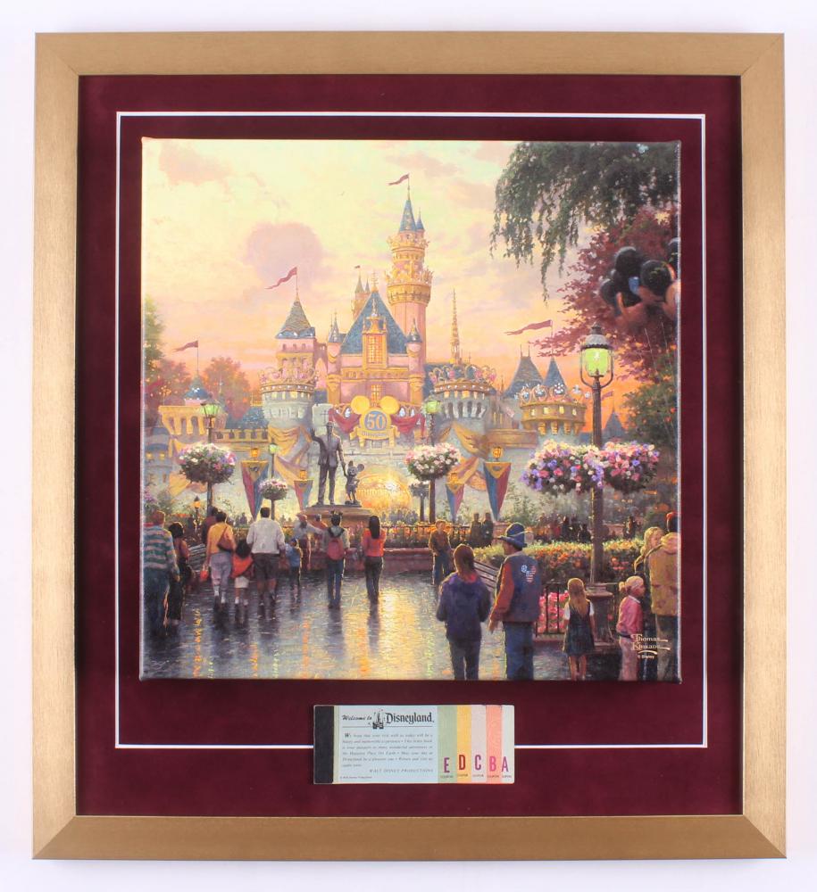 "Thomas Kinkade 50th Anniversary ""Disneyland"" 20x22 Custom Framed Canvas on Wood Display with Full Vintage Ticket Book at PristineAuction.com"