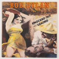 "Bob Dylan Signed ""Knocked Out Loaded"" Vinyl Record Album Inscribed ""7 1 86"" (REAL LOA & JSA ALOA) at PristineAuction.com"