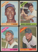 Lot of (4) 1966 Topps Baseball Cards with #110 Ernie Banks, #390 Brooks Robinson, #365 Roger Maris & #300 Bob Clemente
