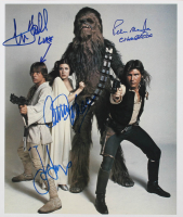 "Star Wars 12x14 Photo Signed by (4) With Harrison Ford, Carrie Fisher, Mark Hamill & Peter Mayhew Inscribed ""Chewbacca"" & ""Luke"" (Beckett LOA) at PristineAuction.com"