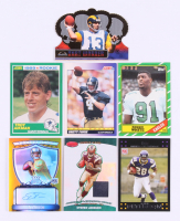 Lot of (7) Assorted Football Rookie Cards with 1999 Crown Royale #116 Kurt Warner RC, 1989 Score #270 Troy Aikman RC, 1991 Score #611 Brett Favre RC, 1986 Topps #275 Reggie White RC