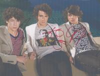 Nick Jonas, Kevin Jonas & Joe Jonas Signed 8x10 Photo (JSA LOA)