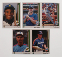 1989 Upper Deck The Collector's Choice Complete Set of (800) Baseball Cards with #25 Randy Johnson RC, #273 Craig Biggio RC, #1 Ken Griffey Jr. RC, #652A Pat Sheridan ERR / No position on front, #357A Dale Murphy ERR / Front has / reverse negativ at PristineAuction.com