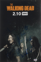 """The Walking Dead"" 12x18 Photo Cast-Signed by (8) with Norman Reedus, Jeffrey Dean Morgan, Ryan Hurst, Cailey Flemming Inscribed ""XO"" (PSA LOA) at PristineAuction.com"