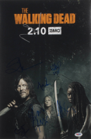 """The Walking Dead"" 12x18 Photo Cast-Signed by (7) with Ryan Hurst, Melissa McBride, Cailey Fleming, Cooper Andrews Inscribed ""XO"" (PSA LOA) at PristineAuction.com"