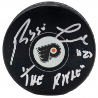 "Reggie Leach Signed Flyers Logo Hockey Puck Inscribed ""The Rifle"" (JSA COA) at PristineAuction.com"