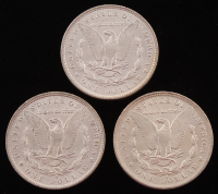 Lot of (3) Morgan Silver Dollars with 1884-O, 1884-O, & 1886 at PristineAuction.com