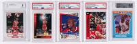 Lot of (5) Graded Michael Jordan Basketball Cards with 1997-98 Collector's Choice #191 / Catch 23 Media Circus (PSA 7), 1993-94 Upper Deck #SP3 Michael Jordan / Wilt Chamberlain (PSA 9), 1993-94 Upper Deck International German #23 (JSA 9)
