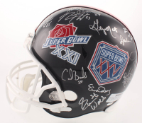 New York Giants Super Bowl XXI & XXV Champions Full-Size Helmet Team-Signed by (28) with Phil Simms, Lawrence Taylor, Jeff Hostetler, Ottis Anderson (Schwartz COA) at PristineAuction.com
