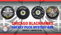 Chicago Blackhawks Signed Mystery Box Logo Hockey Puck - Champions Edition Series 8 - (Limited to 50) at PristineAuction.com