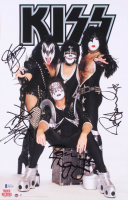 Kiss 11x17 Photo Band-Signed by (4) with Gene Simmons, Paul Stanley, Peter Criss, & Tommy Thayer (Beckett LOA) at PristineAuction.com