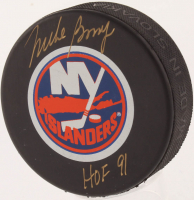 "Mike Bossy Signed New York Islanders Logo Hockey Puck Inscribed ""HOF 91"" (JSA COA) at PristineAuction.com"