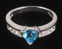 Sterling Silver Trillion Swiss Blue Topaz Ring at PristineAuction.com