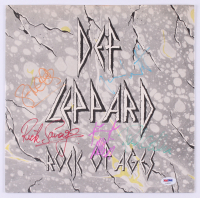 """Def Leppard """"Rock of Ages"""" Vinyl Record Album Band-Signed by (5) with Phil Collen, Rick Allen, Rick Savage, Joe Elliott & Steve Clark (PSA LOA) at PristineAuction.com"""