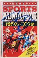 "Michael J. Fox & Christopher Lloyd Signed ""Grays Sports Almanac: 1950-2000"" Paperback Book (Beckett COA) at PristineAuction.com"