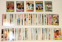 Lot of (166) 1983 Topps Football Cards with #164 Dwight Clark, #49 Ed Jones, #3 Dan Fouts, #33 Jim McMahon RC, #382 Kellen Winslow at PristineAuction.com