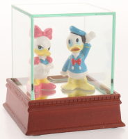 Lot of (2) Vintage Disney Ceramic Figurines with Donald Duck & Daisy with High Quality Display Case at PristineAuction.com