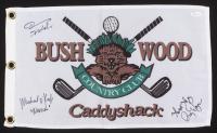 "John F. Barmon Jr., Cindy Morgan & Michael O'Keefe Signed ""Caddyshack"" 12x21 Bushwood Pin Flag with Multiple Inscriptions (JSA COA) at PristineAuction.com"