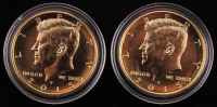 Set of (2) 2015 Gold Half Dollar Coins at PristineAuction.com