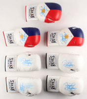 "Lot of (7) Manny Pacquiao Signed Boxing Gloves Inscribed ""Pacman"" (Beckett COA) at PristineAuction.com"