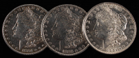 Lot of (3) Morgan Silver Dollars with 1884, 1885, & 1921 at PristineAuction.com