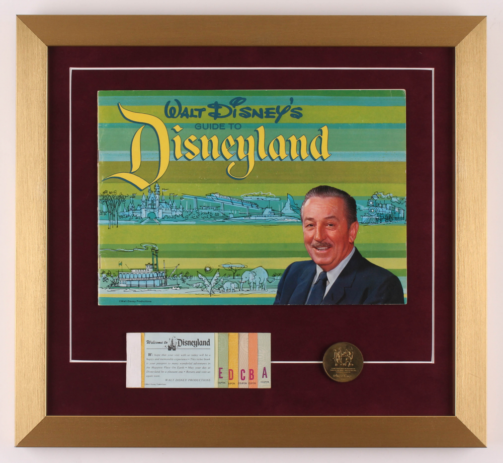 "Walt Disney's ""Disneyland"" 16x17.5 Custom Framed 1964 Original Guide Display with Vintage Ticket Booklet & Solid Brass Coin at PristineAuction.com"