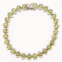 "Silver 13.72ct Peridot Line Bracelet 7.25"" at PristineAuction.com"