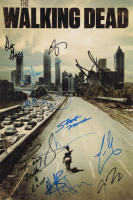 """The Walking Dead"" 12x18 Photo Signed by (12) with Andrew Lincoln, Greg Nicotero, Josh McDermitt, Melissa McBride with Inscriptions (AutographCOA Hologram) at PristineAuction.com"