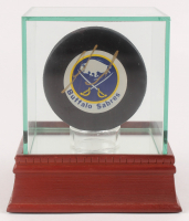 Alexander Mogilny Signed Sabres Logo Hockey Puck with Display Case (PSA COA) at PristineAuction.com