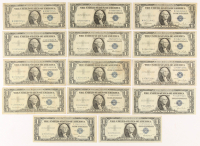 Lot of (14) 1935-57 U.S. $1 One Dollar Blue Seal Silver Certificate Notes at PristineAuction.com