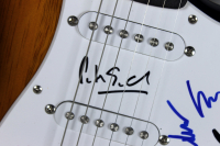 Genesis Electric Guitar Band-Signed by (4) with Peter Gabriel, Steve Hackett, Mike Rutherford & Tony Banks (Beckett LOA) at PristineAuction.com