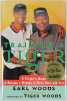 "Tiger Woods Signed ""Training A Tiger"" Hardcover Book Inscribed ""All the Best"" (PSA LOA) at PristineAuction.com"