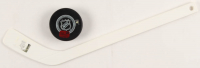 Brandon Saad Signed Lot of (2) with 2014 Stadium Series Hockey Puck & 2014 Stadium Series Mini Hockey Stick (Saad COA) at PristineAuction.com