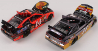 Lot of (2) Tony Stewart LE 1:24 Scale Die Cast Cars with (1) #14 Rush Trucks 2014 SS Color Chrome & (1) #14 Bass Pro Shops 2014 SS Elite at PristineAuction.com