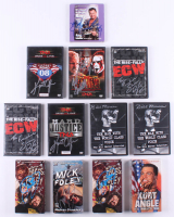 Lot of (12) Signed Assorted Wrestling (7) DVD's, (4) VHS's & (1) Audio Book with Bill Mercer, Shane Douglas, Kurt Angle, Jeff Jarrett, Mick Foley (JSA ALOA) at PristineAuction.com