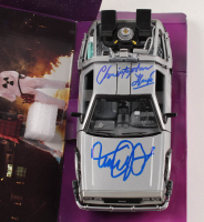 "Michael J. Fox & Christopher Lloyd Signed ""Back to the Future"" DeLorean Time Machine 1:24 Scale Die-Cast Car (PSA LOA) at PristineAuction.com"