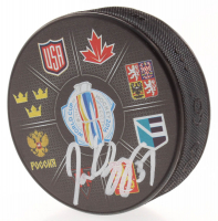 Patrice Bergeron Signed 2016 World Cup of Hockey Logo Hockey Puck (Bergeron COA) at PristineAuction.com