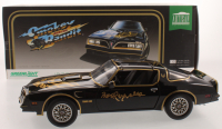 "Burt Reynolds Signed ""Smokey & the Bandit"" 1977 Pontiac Firebird 1:18 Diecast Car (Beckett COA) at PristineAuction.com"