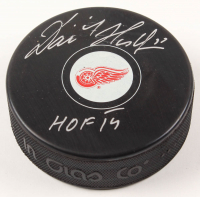 "Dominik Hasek Signed Red Wings Logo Hockey Puck Inscribed ""HOF 14"" (Schwartz COA) at PristineAuction.com"