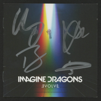 "Imagine Dragons ""Evolve"" CD Booklet Band-Signed by (4) with Dan Reynolds, Ben McKee, Wayne Sermon & Daniel Platzman (JSA COA) at PristineAuction.com"