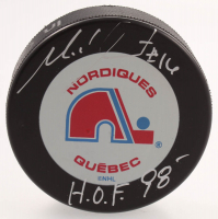 """Michel Goulet Signed Nordiques Logo Hockey Puck Inscribed """"H.O.F. 98 (Schwartz COA & AJ's Sports World Hologram) at PristineAuction.com"""
