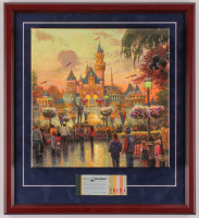 "Thomas Kinkade 50th Anniversary ""Disneyland"" 20x22 Custom Framed Canvas on Wood Display with Full Vintage Ticket Booklet at PristineAuction.com"