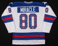 """Jersey Team-Signed by (14) with Jim Craig, Mike Eruzione, Mark Johnson, John Harrington Inscribed """"Do You Believe In Miracles"""" (Beckett COA) at PristineAuction.com"""
