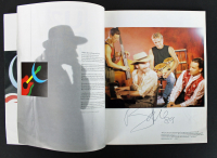 """U2 """"Love Comes to Town Tour"""" Program Band-Signed by (4) with Bono, The Edge, Larry Mullen Jr. & Adam Clayton (PSA LOA) at PristineAuction.com"""