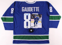 Lot of (3) Adam Gaudette Signed Canucks Logo Items with, Hockey Puck, Jersey & 8x10 Photo (Gaudette COA) at PristineAuction.com